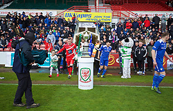 WREXHAM, WALES - Monday, May 2, 2016: The New Saints's goalkeeper Paul Harrison and Airbus UK Broughton's Matty McGinn walk past the trophy before the 129th Welsh Cup Final at the Racecourse Ground between The New Saints and Airbus UK Broughton. (Pic by David Rawcliffe/Propaganda)
