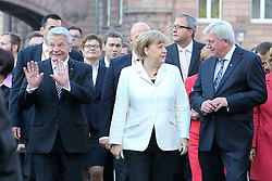 03.10.2015, Frankfurt am Main, GER, Tag der Deutschen Einheit, im Bild Bundespräsident Joachim Gauck grüßt die Bürger am Strassenrand beim Gang von Paulskirche zum Frankfurter Dom neben Bundeskanzlerin Angela Merkel und Ministerpräsident Hessen Volker Bouffier // during the celebrations of the 25 th anniversary of German Unity Day in Frankfurt am Main, Germany on 2015/10/03. EXPA Pictures © 2015, PhotoCredit: EXPA/ Eibner-Pressefoto/ Roskaritz<br /> <br /> *****ATTENTION - OUT of GER*****