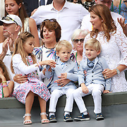LONDON, ENGLAND - JULY 16: Roger Federer's wife Mirka Federer and their four children, identical twin daughters Myla and Charlene, 7, and identical 3-year-old twin sons Leo and Lenny, cheer from the stands after the Gentlemen's Singles final won by Roger Federer during the Wimbledon Lawn Tennis Championships at the All England Lawn Tennis and Croquet Club at Wimbledon on July 16, 2017 in London, England. (Photo by Tim Clayton/Corbis via Getty Images)