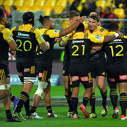 The Hurricanes congratulate Beauden Barrett on his late try during the Super Rugby match between the Hurricanes and Southern Kings at Westpac Stadium, Wellington, New Zealand on Friday, 25 March 2016. Photo: Dave Lintott / lintottphoto.co.nz