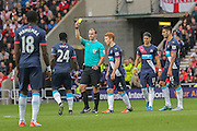Newcastle United midfielder Cheik Ismael Tiote receives his yellow card  during the Barclays Premier League match between Sunderland and Newcastle United at the Stadium Of Light, Sunderland, England on 25 October 2015. Photo by Simon Davies.