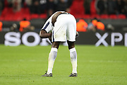 Davinson Sanchez of Tottenham Hotspur (6) looking down at pitch after loss during the Champions League match between Tottenham Hotspur and Juventus FC at Wembley Stadium, London, England on 7 March 2018. Picture by Matthew Redman.