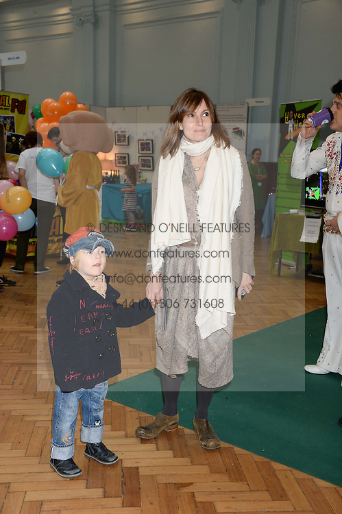DAISY BATES and her son WOODY at the Plusher Fair, Lindley Hall, Royal Horticultural Halls, Vincent Square, London, on 9th November 2013.