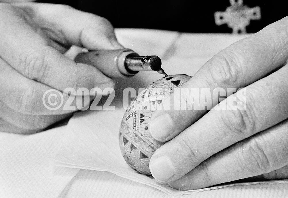 Sister Josaphat Slobodian draws a pattern on an egg while doing Ukrainian egg decorating, or pysanky, Tuesday, May 01, 1990 at Sisters of Saint Basil The Great motherhouse in Glenside, Pennsylvania. (Photo by William Thomas Cain/Cain Images)