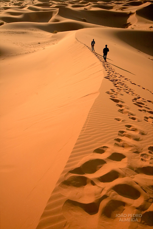 Man at the dunes of the Moroccan Sahara