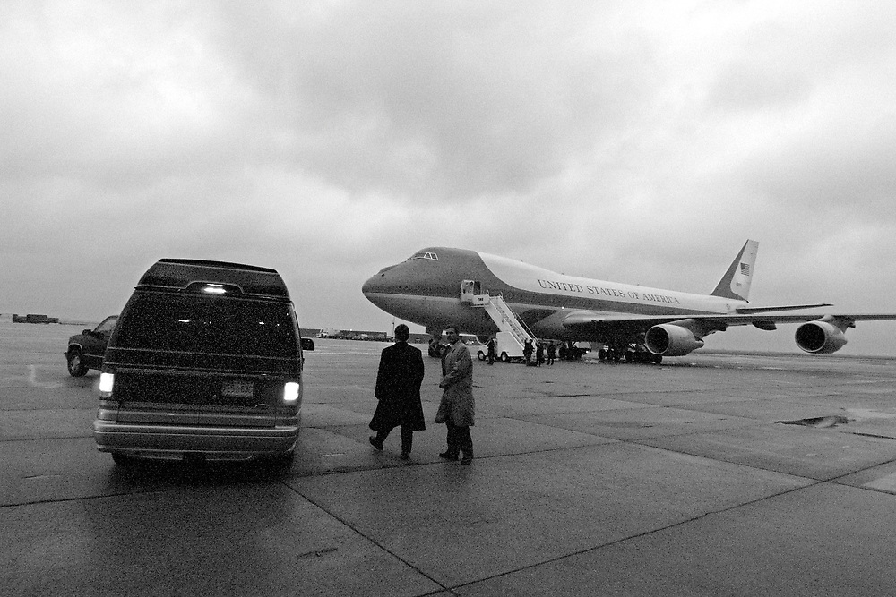 Back in the van:  The Clinton drive off in a van to their home in NY after leaving a rally at JFK Airport.  Air Force One is in the background.