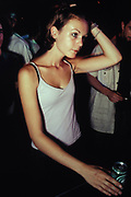 Female clubber drinking can of beer, Paris, France, 1999.
