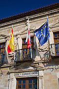Ayuntamiento, County Hall, 16th Century with flags of Cantabria, Spain and EU in San Vicente de la Barquera, Northern Spain