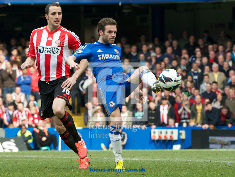 Picture by Alan Stanford/Focus Images Ltd +44 7915 056117.07/04/2013.Juan Mata of Chelsea hold up the ball from John O'Shea of Sunderland during the Barclays Premier League match at Stamford Bridge, London.