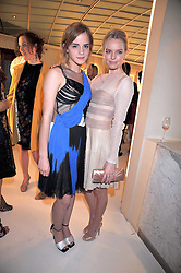 Left to right, EMMA WATSON and KATE BOSWORTH at a dinner in honour of design label Rodarte held at the Fifth Floor Restaurant, Harvey Nichols, Knightsbridge, London on 3rd June 2009.