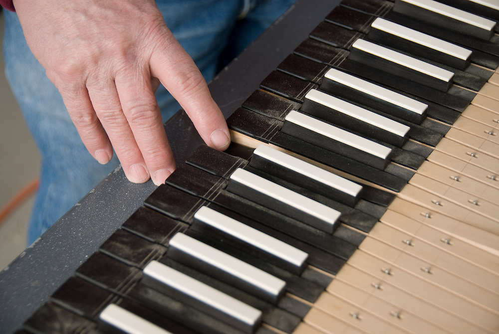 Man playing a harpsichord