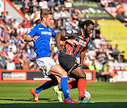 Michael Morrison and Kenwyne Jones during the Sky Bet Championship match between Bournemouth and Birmingham City at the Goldsands Stadium, Bournemouth, England on 6 April 2015. Photo by Adam Rivers.