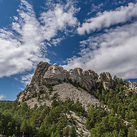 Mount Rushmore on a beautiful summer day.  Mount Rushmore is located near Keystone, South Dakota.  Carved into the granite face are four United States president, George Washington, Thomas Jefferson, Theodore Roosevelt and Abraham Lincoln.