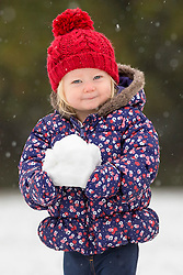 © Licensed to London News Pictures. 09/11/2016. Leeds UK. Picture shows one year old Scarlet playing in the snow for the first time at Temple Newsam park in Leeds after heavy snowfall this morning. Photo credit: Andrew McCaren/LNP