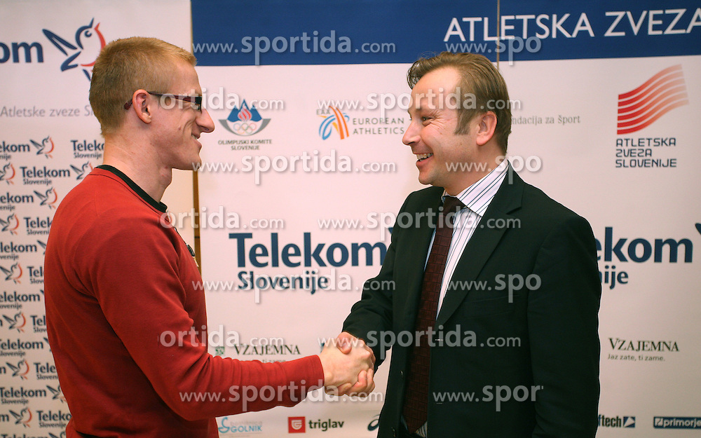 Matic Osovnikar and president of AZS dr. Peter Kukovica when Athletic Federation of Slovenia (AZS) and top Slovenian athletes sign a contract of sponsorship, on February 14, 2008 in M-Hotel, Ljubljana, Slovenia. (Photo by Vid Ponikvar / Sportal Images)
