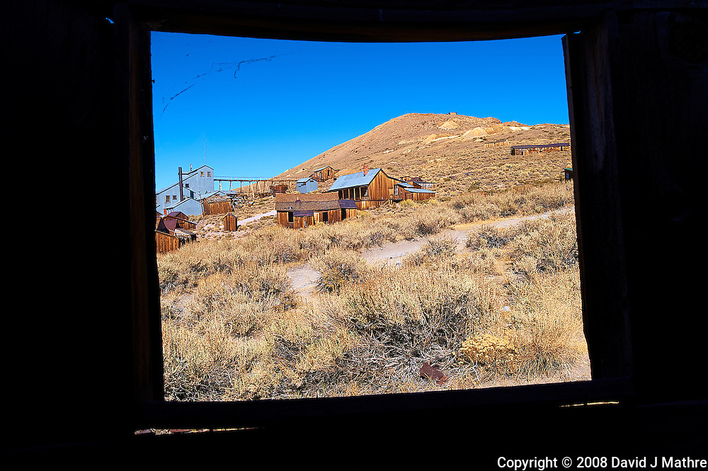 Looking Out a Window at Bodie State Park in California. Image taken with a Nikon D3 and 24 mm f/3.5 PC-E lens (ISO 200, 24 mm, f/16, 1/250 sec).