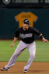 June 29, 2011; Oakland, CA, USA; Florida Marlins catcher John Buck (14) leads off first base against the Oakland Athletics during the seventh inning at the O.co Coliseum.  Florida defeated Oakland 3-0.