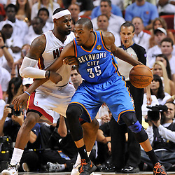 Jun 17, 2012; Miam, FL, USA; Oklahoma City Thunder small forward Kevin Durant (35) is guarded by Miami Heat small forward LeBron James (6) during the fourth quarter in game three in the 2012 NBA Finals at the American Airlines Arena. Miami won 91-85. Mandatory Credit: Derick E. Hingle-US PRESSWIRE