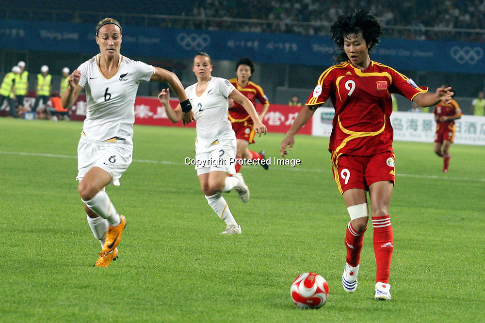 Rebecca Smith (NZ) chases the ball during the Women's Friendly football match between New Zealand and China, held in China, 22 July 2008. Photo: ChinaFotoPress