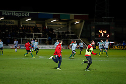 Blyth Spartans players run accross to their fans after they win 1-2 to progress to the next round of the FA Cup - Photo mandatory by-line: Rogan Thomson/JMP - 07966 386802 - 05/12/2014 - SPORT - FOOTBALL - Hartlepool, England - Victoria Park - Hartlepool United v Blyth Spartans - FA Cup Second Round Proper.