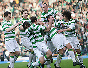 Darren O'Dea is mobbed by team-mates after scoring the opener during the League Cup final between Rangers and Celtic at Hampden Park -<br /> David Young
