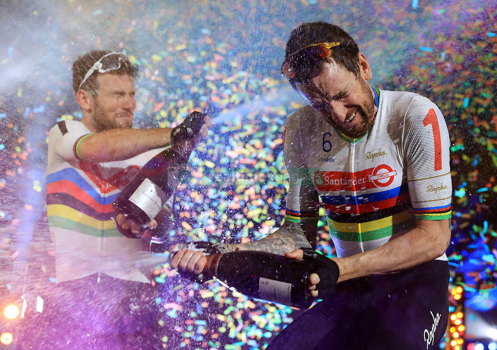Great Britain's Mark Cavendish (left) and Sir Bradley Wiggins spray champagne after finishing second in the Six Day London Event at Lee Valley Velopark, London.
