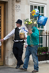 10/06/2013. London, UK. Flowers and balloons arrive at The Clinic on Harley Street. Prince Philip, Duke of Edinburgh, who is celebrating his 92nd birthday  is currently recovering at the hospital after undergoing a planned operation to cure abdominal pains. Photo credit: Ben Cawthra