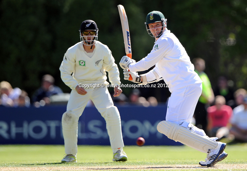 South African captain Graeme Smith batting as Kane Williamson looks on during play on Day 3 of the first test match between South Africa and New Zealand at the University Oval in Dunedin, New Zealand on Friday 9 March 2012. Photo: Andrew Cornaga/Photosport.co.nz