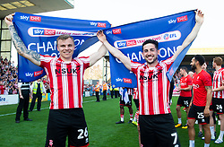Harry Anderson of Lincoln City and Tom Pett of Lincoln City celebrate winning the league.  - Mandatory by-line: Alex James/JMP - 22/04/2019 - FOOTBALL - Sincil Bank Stadium - Lincoln, England - Lincoln City v Tranmere Rovers - Sky Bet League Two