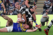 Leeds Rhinos prop forward Anthony Mullally (16) is tackled by Hull FC hooker Danny Houghton (9) during the Betfred Super League match between Hull FC and Leeds Rhinos at Kingston Communications Stadium, Hull, United Kingdom on 19 April 2018. Picture by Mick Atkins.