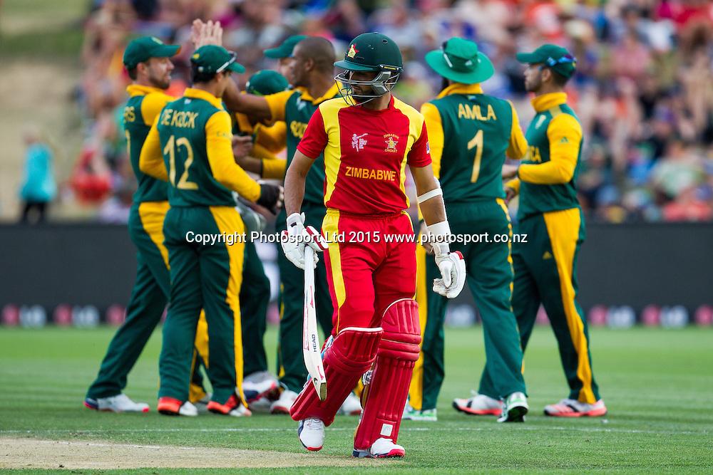 Zimbabwe's Sikandar Raza departs after his dismissal during the ICC Cricket World Cup match - South Africa v Zimbabwe at Seddon Park, Hamilton, New Zealand on Sunday 15 February 2015.  Photo:  Bruce Lim / www.photosport.co.nz