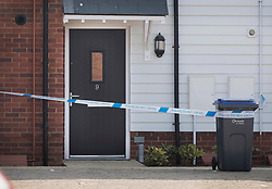 © Licensed to London News Pictures. 04/07/2018. Amesbury, UK. Police tape surrounds the front door of property in Muggleton Road, Amesbury after a couple named locally as Dawn Sturgess, 44, and her partner Charlie Rowley, 45, were taken ill on Saturday 30th June 2018. Police have confirmed that the couple have been in contact with Novichok nerve agent. Former Russian spy Sergei Skripal and his daughter Yulia were poisoned with Novichok nerve agent in nearby Salisbury in March 2018.Photo credit: Peter Macdiarmid/LNP