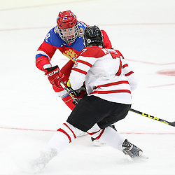 COBOURG, - Dec 19, 2015 -  Gold Metal Game - Russia vs Canada West at the 2015 World Junior A Challenge at the Cobourg Community Centre, ON. Kirill Slepets #19 of Team Russia and Cale Makar #7 of Team Canada West battle for the puck during the first period. (Photo: Tim Bates / OJHL Images)