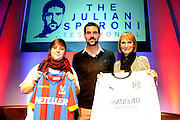 Two fans picked from the audience help Julian Speroni help announce that Dundee will be the opponents in his testimonial match duringThe gloves are off. An Evening With Julian Speroni at  at Fairfields Hall, Croydon, United Kingdom on 20 January 2015. Photo by Michael Hulf.