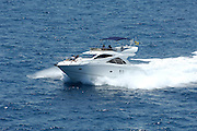 Motor launch at speed in open water