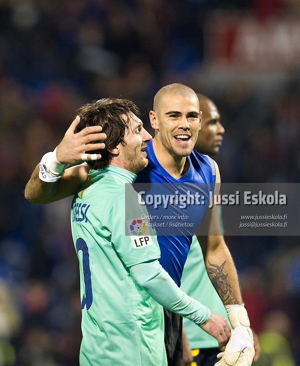 Victor Valdes, Lionel Messi. Hercules - Barcelona. La Liga. Alicante, Espanja 29.1.2011. Photo: Jussi Eskola