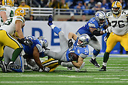 DETROIT, MI - JANUARY 01: Lions running back Zach Zenner (34) gets tripped up during a NFC North NFL football game between Detroit and Green Bay on January 1, 2017, at Ford Field in Detroit, MI. (Photo by Adam Ruff/Icon Sportswire)