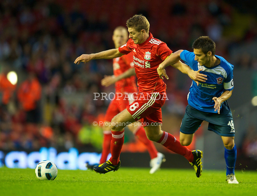 LIVERPOOL, ENGLAND - Thursday, August 5, 2010: Liverpool's captain Steven Gerrard MBE in action against FK Rabotnicki's captain Nikola Gilgorov during the UEFA Europa League 3rd Qualifying Round 2nd Leg match at Anfield. (Pic by: David Rawcliffe/Propaganda)