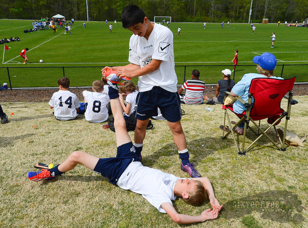 Gary Cosby Jr./Decatur Daily   The Open Cup Soccer tournament concludes Sunday at the Jack Allen Recreation Complex in Decatur Sunday.  The tournament featured teams from across the region and several from outside the country.  Emrakh Kamalov helps his teammate Jacob Bousquet stretch before a game.  They play for IFA from Knoxville, TN.