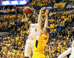 Jan 20, 2018; Morgantown, WV, USA; Texas Longhorns forward Mohamed Bamba (4) shoots over West Virginia Mountaineers forward Logan Routt (31) during the first half at WVU Coliseum. Mandatory Credit: Ben Queen-USA TODAY Sports