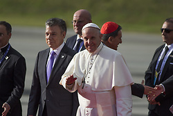 September 6, 2017 - Bogota, Colombia - Pope Francis gestures next to Colombian President Juan Manuel Santos (L) during his welcoming ceremony upon landing in Bogota on September 6, 2017. Pope Francis arrived in Colombia for a five-day tour to plead for a 'stable and lasting' peace in a divided country just emerging from a 50-year war that claimed hundreds of thousands of lives. (Credit Image: © Daniel Garzon Herazo/NurPhoto via ZUMA Press)