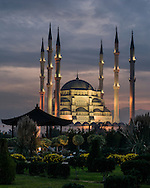Sabanci Merkez Camii, Adana Mosque is illuminated by lights at sunset