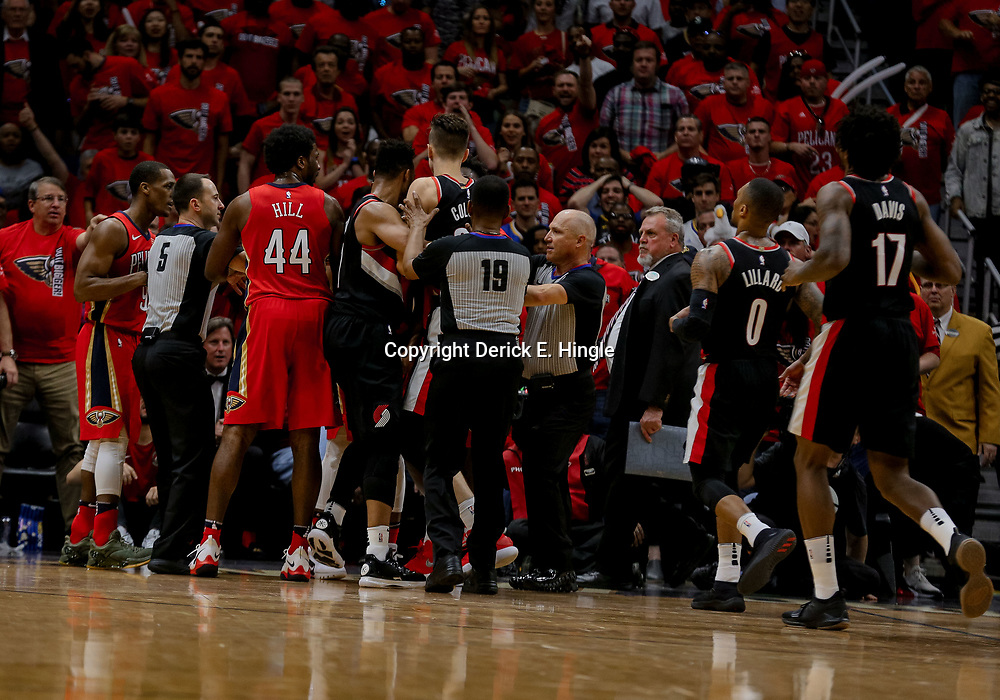 Apr 21, 2018; New Orleans, LA, USA; New Orleans Pelicans guard Rajon Rondo (9) and Portland Trail Blazers center Zach Collins (33) a separated by officials during the second quarter in game four of the first round of the 2018 NBA Playoffs at the Smoothie King Center. Mandatory Credit: Derick E. Hingle-USA TODAY Sports