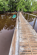 Bamboo Monkey Bridge - with nautical origins, a monkey bridge or flying bridge are commonly found in Southeast Asia over creeks and rivers to give locals access to neighboring areas. Sometimes not much more than a couple ropes or bamboo poles, it is used only for foot traffic.  The boat type of flying gangway is a catwalk raised fore-and-aft which allows safe passage when the deck is washed by heavy seas.