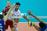 Poland's Michal Winiarski spikes the ball while volleyball final match between Brazil and Poland during the 2014 FIVB Volleyball World Championships at Spodek Hall in Katowice on September 21, 2014.<br /> <br /> Poland, Katowice, September 21, 2014<br /> <br /> For editorial use only. Any commercial or promotional use requires permission.<br /> <br /> Mandatory credit:<br /> Photo by &copy; Adam Nurkiewicz / Mediasport