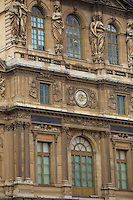 The entrance facade of the Louvre Museum in Paris, France.