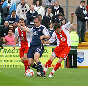 Nicky Riley tackles former Dee Steven Milne - Ross County v Dundee - IRN BRU Scottish Football League First Division at Victoria Park<br /> <br /> <br /> <br /> http://www.davidyoungphoto.co.uk