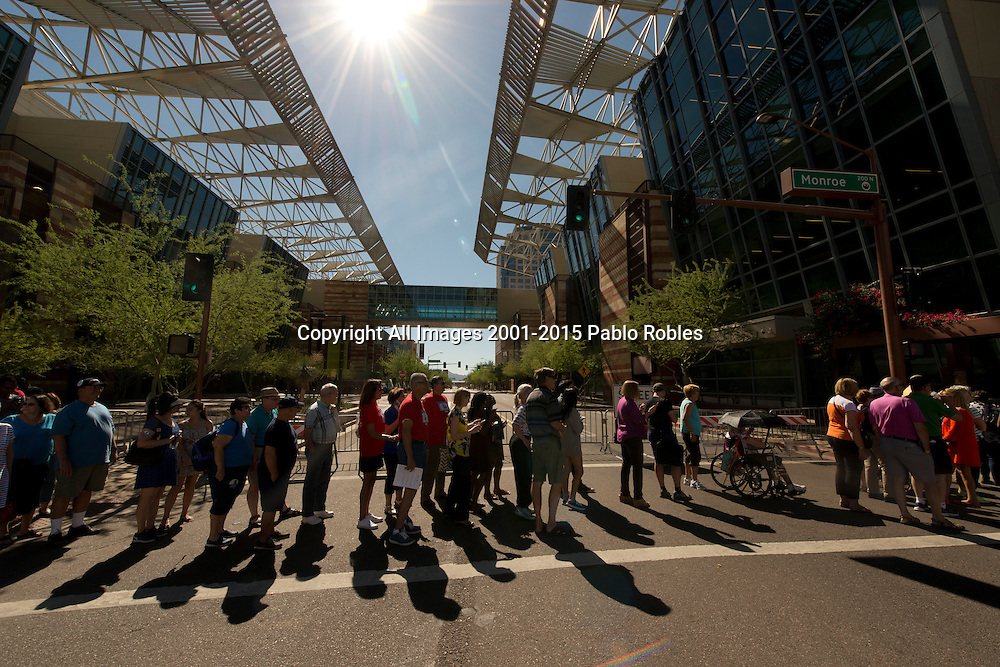October 20, 2016. Attendees gather at the Phoenix Convention Center to hear Michelle Obama speak during Hillary Clinton's 2016 presidential campaign in Downton Phoenix, AZ. Spot News, General News images for Newspapers by Photojournalist Pablo Robles.