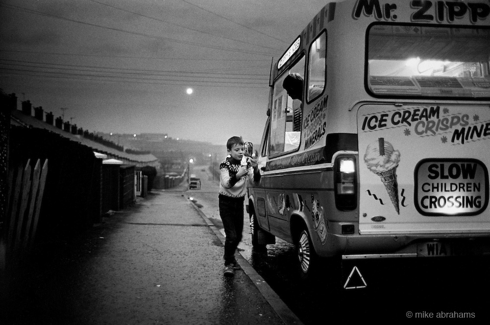 Mr Zippy. Boy buying ice cream. Ardoyne, Belfast 1987. Northern Ireland