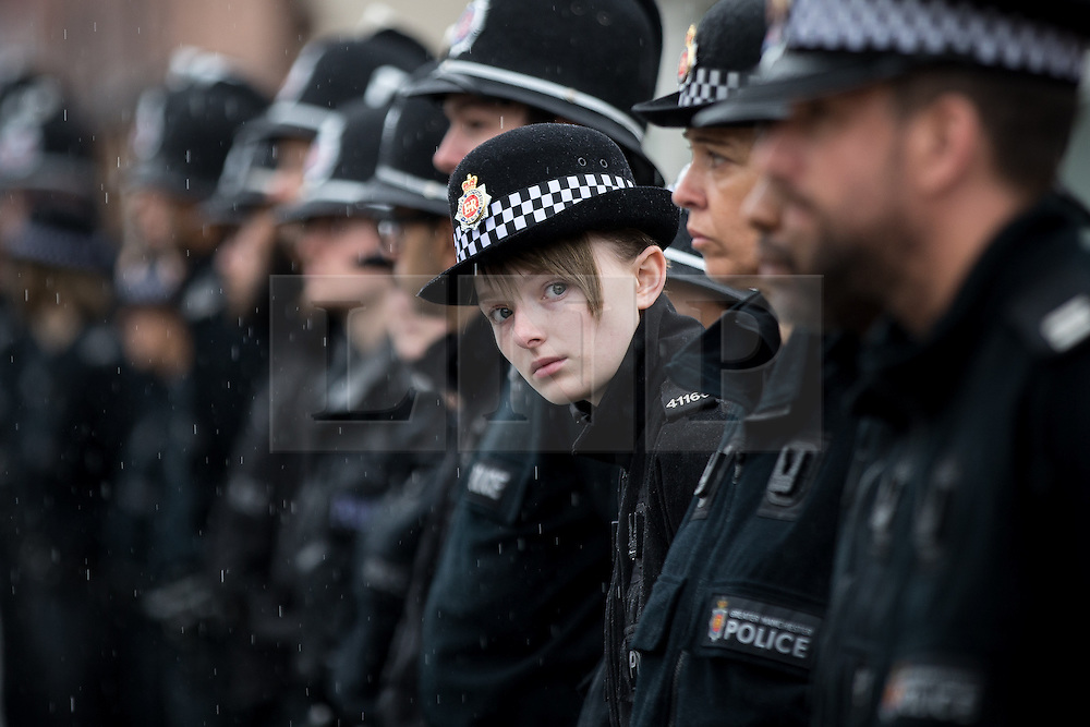 © Licensed to London News Pictures . 15/07/2016 . Bolton , UK . Police officers line the street outside the church , after the service .  The funeral of Special Constable Samantha Derbyshire at St Mary's RC Church in Horwich , Bolton. Derbyshire was struck and killed by an HGV on the M61 motorway following a collision , in the early hours of Monday 11th July 2016 . Photo credit : Joel Goodman/LNP